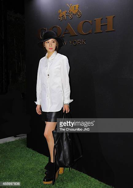 Kim AJoong poses for photographs during the Coach 'Stuart Vevers Collection' launching party at Shinsegae department store on September 19 2014 in...