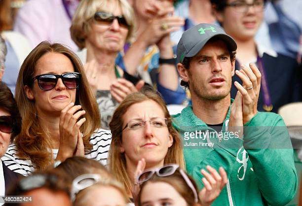 Kim and Andy Murray watch John Peers of Australia and Jamie Murray of Great Britain in action in the Final Of The Gentlemen's Doubles against Horia...