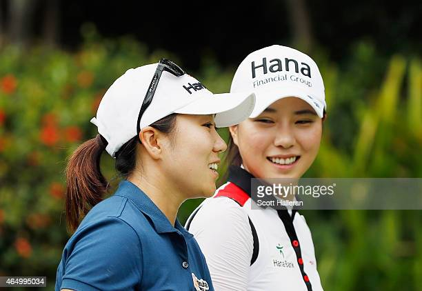 K Kim and Hee Young Park of South Korea walk together during a practice round prior to the start of the HSBC Women's Champions at the Sentosa Golf...