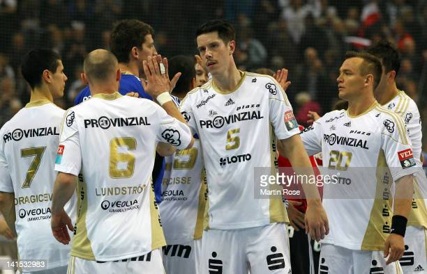 Kim Andersson of Kiel celebrate with his team mates after the EHF Champions League second leg match between THW Kiel and Orlen Wisla Plock at...