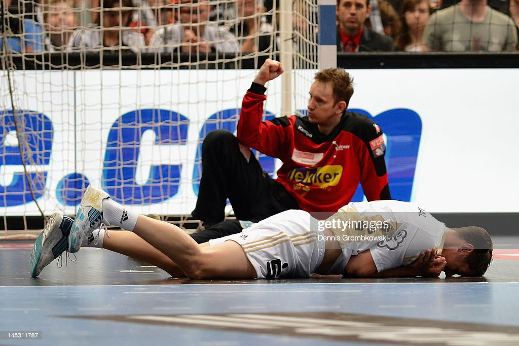 <a gi-track='captionPersonalityLinkClicked' href=/galleries/search?phrase=Kim+Andersson&family=editorial&specificpeople=620401 ng-click='$event.stopPropagation()'>Kim Andersson</a> of Kiel lies on the pitch during the EHF Final Four semi final match between Fuechse Berlin and THW Kiel at Lanxess Arena on May 26, 2012 in Cologne, Germany.
