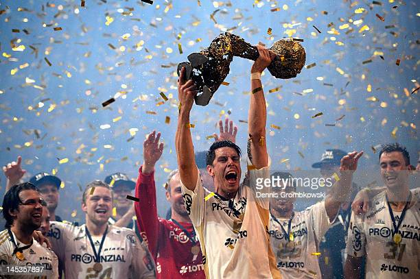 Kim Andersson of Kiel lifts the trophy after the EHF Final Four final match between THW Kiel and BM Atletico Madrid at Lanxess Arena on May 27 2012...