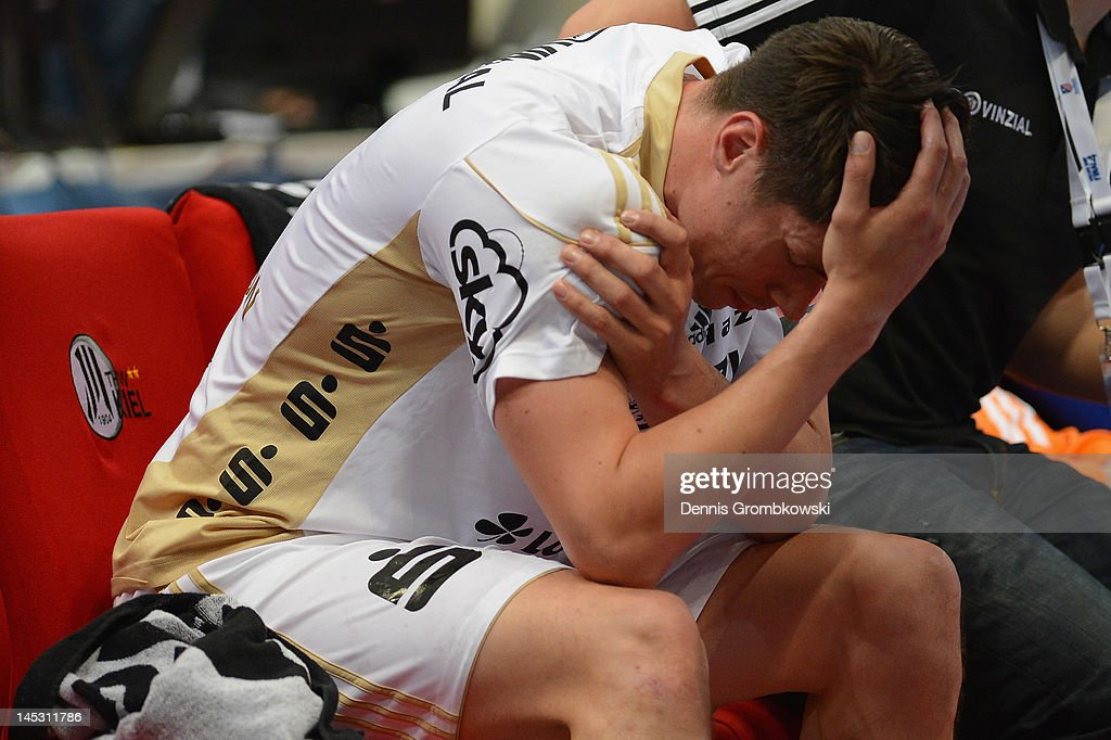 <a gi-track='captionPersonalityLinkClicked' href=/galleries/search?phrase=Kim+Andersson&family=editorial&specificpeople=620401 ng-click='$event.stopPropagation()'>Kim Andersson</a> of Kiel reacts during the EHF Final Four semi final match between Fuechse Berlin and THW Kiel at Lanxess Arena on May 26, 2012 in Cologne, Germany.
