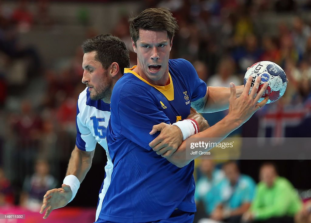 <a gi-track='captionPersonalityLinkClicked' href=/galleries/search?phrase=Kim+Andersson&family=editorial&specificpeople=620401 ng-click='$event.stopPropagation()'>Kim Andersson</a> #5 of Sweden is defended by Alexander Petersson #15 of Iceland in the Men's Preliminaries Group A match between Sweden and Iceland on Day 6 of the London 2012 Olympic Games at The Copper Box on August 2, 2012 in London, England.