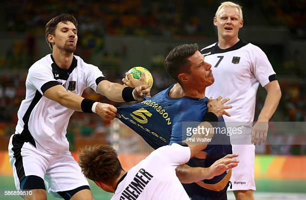 Kim Andersson of Sweden views with Patrick Wiencek Uwe Gensheimer and Fabian Wiede of Germany during the Men's Preliminary Group B match between...