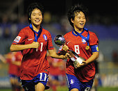 Kim Areum captain of South Korea and teammate Lee Guem Min celebrate with the trophy at the end of of the FIFA U17 Women's World Cup Final match...
