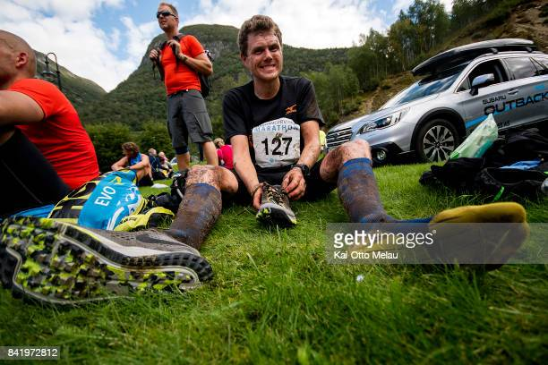 Kim Arne Bull Hansen taking off his socks and shoes at the finishline at Hardangervidda Marathon on September 2 2017 in Eidfjord Norway...