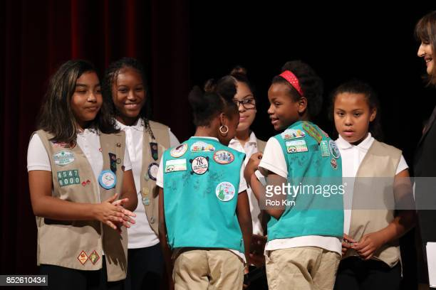 Kim Azzarelli Seneca Women stands on stage with the girls from Troop 6000 at Fast Forward Women's Innovation Forum at The Metropolitan Museum of Art...
