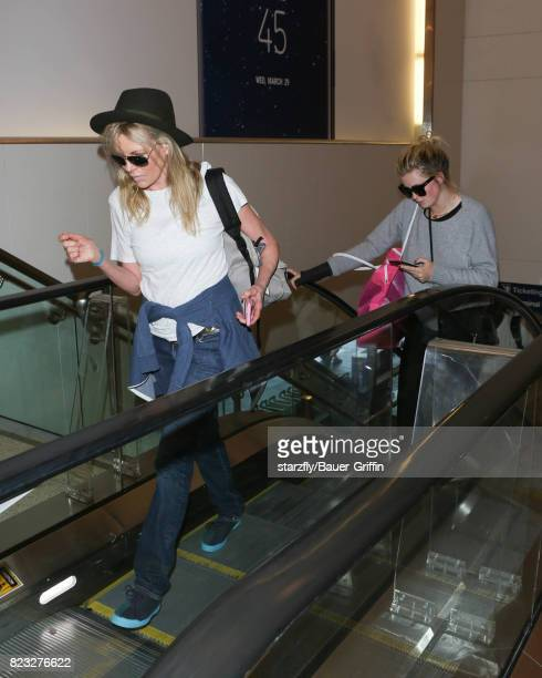 Kim Basinger and Ireland Baldwin is seen at LAX on July 26 2017 in Los Angeles California