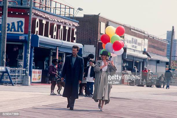 Kim Basinger Mickey Rourke at Coney Island for the filming of 9 1/2 Weeks circa 1980 New York
