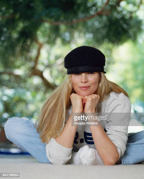 Kim Basinger Sitting With Hands on Chin