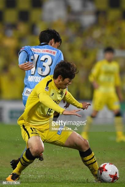 Kim Bo Kyung of aKashiwa Reysol nd Koji Miyoshi of Kawasaki Frontale compete for the ball during the JLeague J1 match between Kashiwa Reysol and...