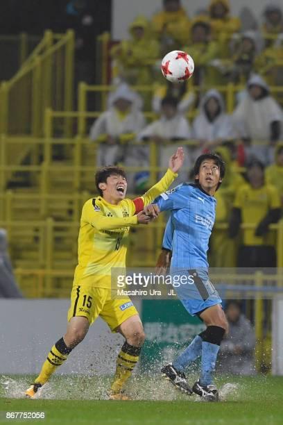 Kim Bo Kyung of Kashiwa Reysol and Kengo Nakamura of Kawasaki Frontale compete for the ball during the JLeague J1 match between Kashiwa Reysol and...