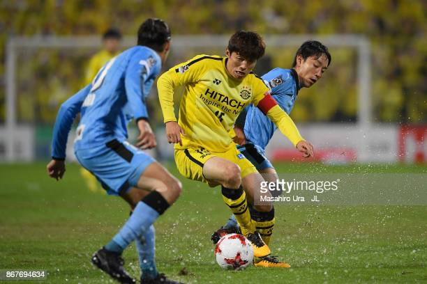 Kim Bo Kyung of Kashiwa Reysol and Koji Miyoshi of Kawasaki Frontale compete for the ball during the JLeague J1 match between Kashiwa Reysol and...