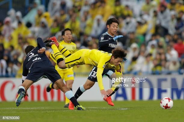 Kim Bo Kyung of Kashiwa Reysol is challenged by Kentaro Oi and Rikiya Uehara of Jubilo Iwata during the JLeague J1 match between Kashiwa Reysol and...