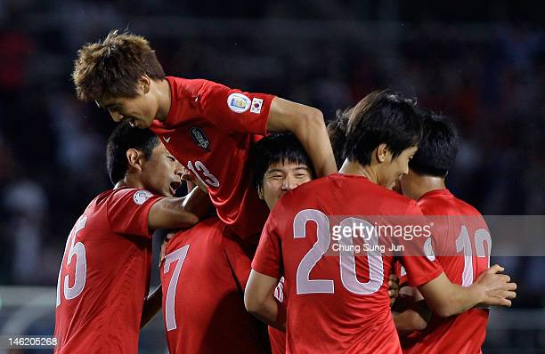 Kim BoKyung of South Korea celebrates after scoring a goal with his team mates Koo JaCheol and Lee DongGook during the FIFA World Cup Asian Qualifier...