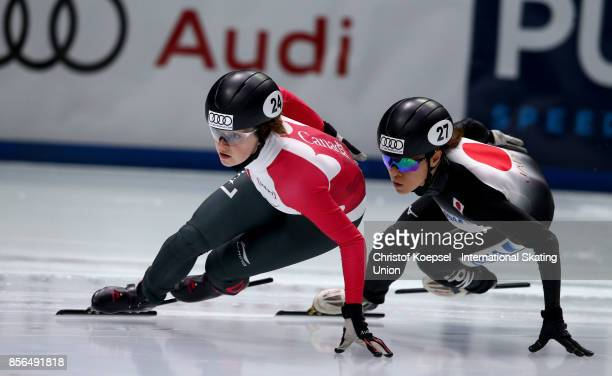Kim Boutin of Canada skates ion front of Sumire Kikuchi of Japan during the ladies 1000m quarterfinals heat two during the Audi ISU World Cup Short...