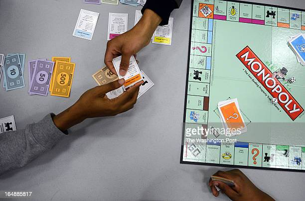 Kim Carrington a community activist organizes a monopoly club every Monday night for a lesson of financial literacy for teenagers particularly those...