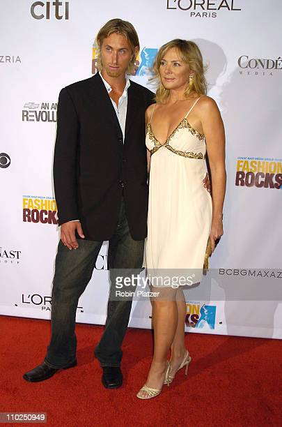 Kim Cattrall and guest during 2005 Fashion Rocks Red Carpet at Radio City Music Hall in New York City New York United States