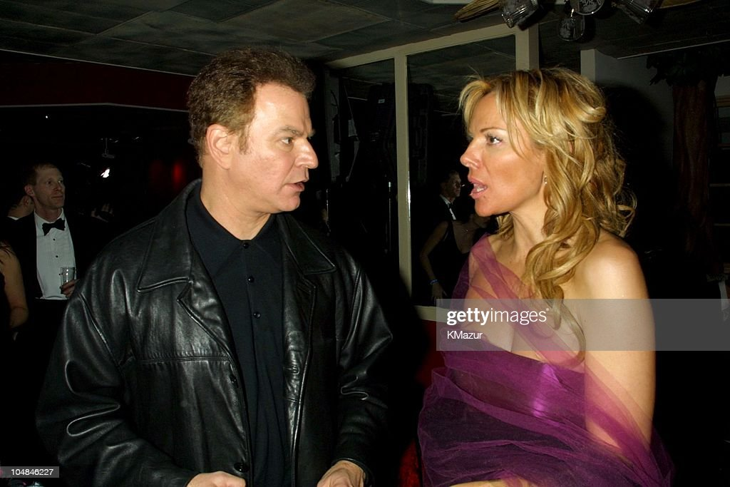 Kim Cattrall and Robert Wuhl during The 58th Annual Golden Globe Awards - HBO After Party at Beverly Hilton in Los Angeles, California, United States.