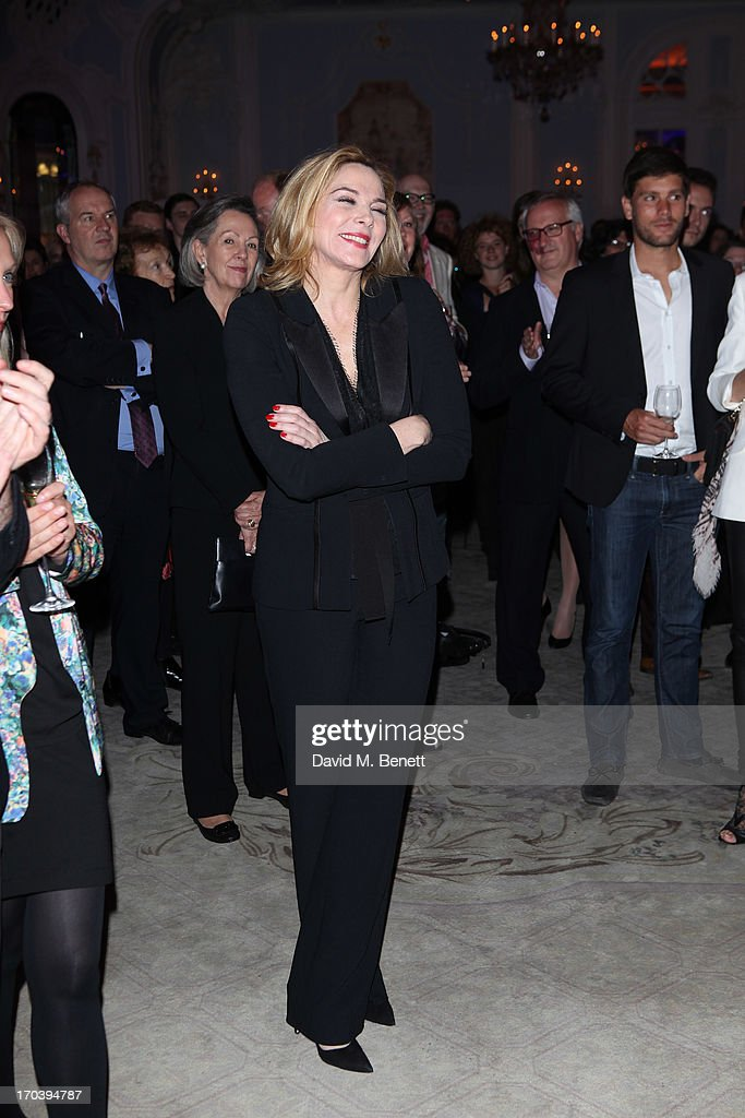 Kim Cattrall listens to Kevin Spacey speak as she attends an after party following the press night performance of The Old Vic's 'Sweet Bird of Youth' at The Savoy Hotel on June 12, 2013 in London, England.