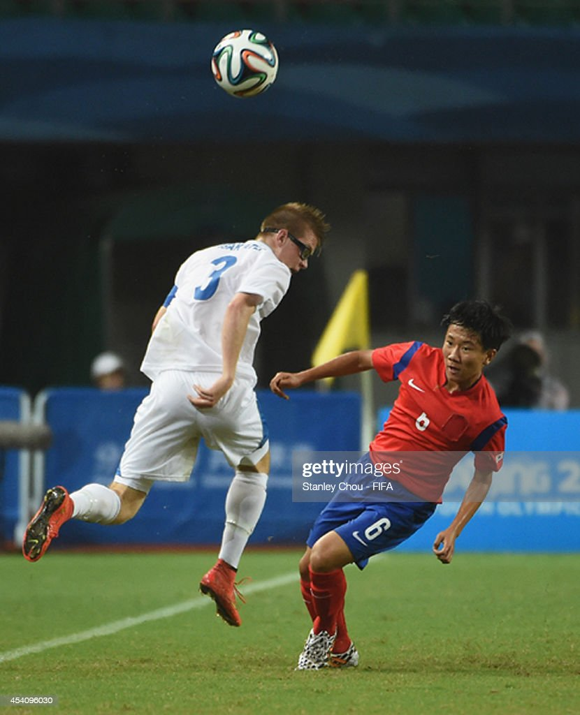 Kim Chan of Korea Republic tackles Isak Atil Kristjansson of Iceland during the 2014 FIFA Boys Summer Youth Olympic Football Tournament Semi Final match between Korea Republic and Iceland at Jiangning Sports Centre Stadium on August 24, 2014 in Nanjing, China.