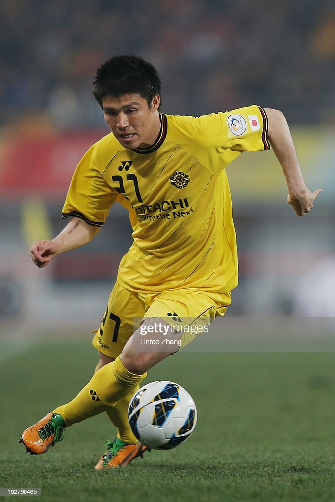Kim Chang Soo of controls the ball during the AFC Champions League match between Guizhou Renhe and Kashiwa Reysol at Olympic Sports Center on February 27, 2013 in Guiyang, China.