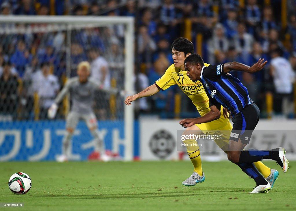Kim Chang-soo of Kashiwa Reysol and Patric of Gamba Osaka compete for the ball during the J.League match between Kashiwa Reysol and Gamba Osaka at Hitachi Kashiwa Soccer Stadium on June 23, 2015 in Kashiwa, Chiba, Japan.