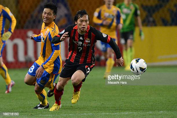 Kim Chi Woo of FC Seoul and Atsushi Yanagisawa of Vegalta Sendai compete for the ball during the AFC Champions League Group E match between Vegalta...
