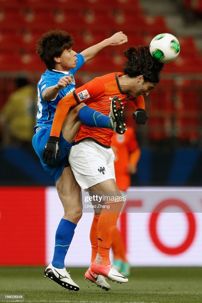 Kim Chigon (L) of Ulsan Hyundai competes for an aerial ball with Aldo De Nigris of Monterrey during the FIFA Club World Cup Quarter Final match between Ulsan Hyundai and CF Monterrey at Toyota Stadium on December 9, 2012 in Toyota, Japan.