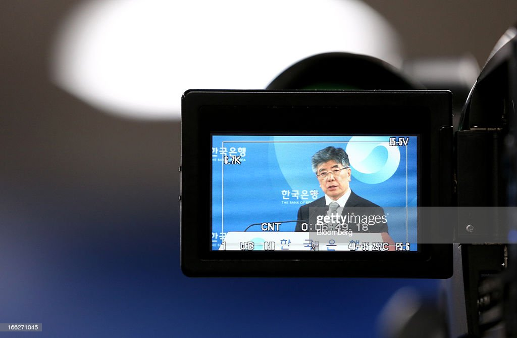 Kim Choong Soo, governor of the Bank of Korea, is seen through a television camera monitor during a news conference after a monetary policy meeting at the central bank's headquarters in Seoul, South Korea, on Thursday, April 11, 2013. The Bank of Korea held borrowing costs unchanged for a sixth month, resisting pressure from the government for a reduction even as a sliding yen hurts the nation's exporters and North Korea threatens war. Photographer: SeongJoon Cho/Bloomberg via Getty Images