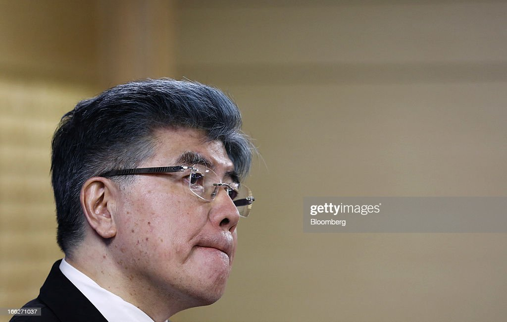 Kim Choong Soo, governor of the Bank of Korea, listens during a news conference following a monetary policy meeting at the central bank's headquarters in Seoul, South Korea, on Thursday, April 11, 2013. The Bank of Korea held borrowing costs unchanged for a sixth month, resisting pressure from the government for a reduction even as a sliding yen hurts the nation's exporters and North Korea threatens war. Photographer: SeongJoon Cho/Bloomberg via Getty Images