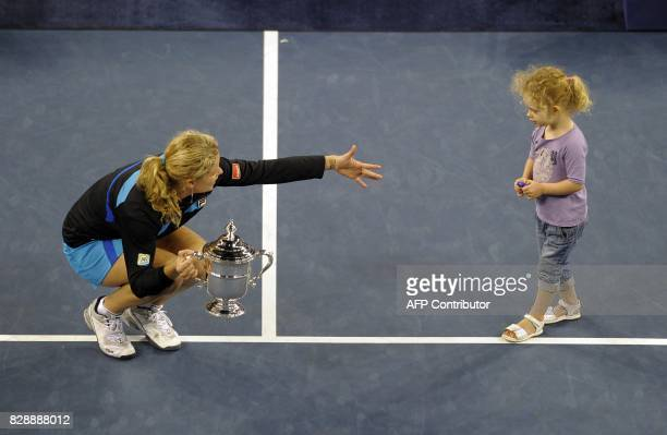 Kim Clijsters from Belgium and her daughter Jada with her trophy after defeating Vera Zvonareva from Russia during the Women's Singles Final at US...