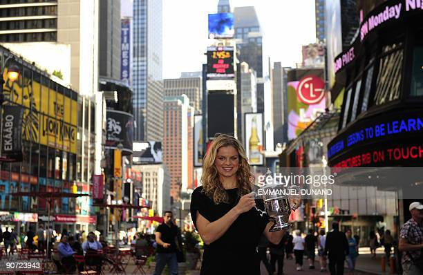 Kim Clijsters from Belgium poses with her trophy in New York's Times Square after her victory against Caroline Wozniacki from Denmark during the...