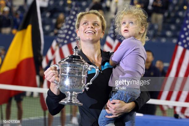 Kim Clijsters of Belgium and daughter Jada pose with the championship trophy after Clijsters defeated Vera Zvonareva of Russia during their women's...