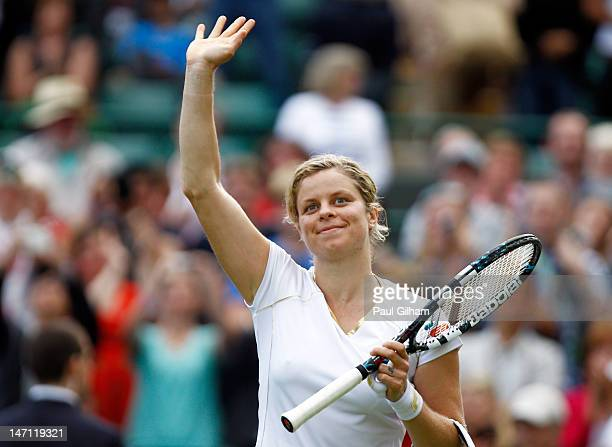 Kim Clijsters of Belgium celebrates match point during her ladies' singles first round match against Jelena Jankovic of Serbia on day one of the...