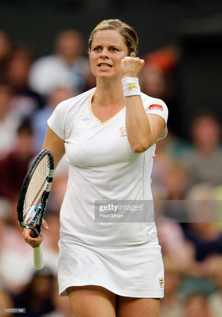 <a gi-track='captionPersonalityLinkClicked' href=/galleries/search?phrase=Kim+Clijsters&family=editorial&specificpeople=178302 ng-click='$event.stopPropagation()'>Kim Clijsters</a> of Belgium celebrates match point during her Ladies' singles second round match against Andrea Hlavackova of Czech Republic on day three of the Wimbledon Lawn Tennis Championships at the All England Lawn Tennis and Croquet Club on June 27, 2012 in London, England.