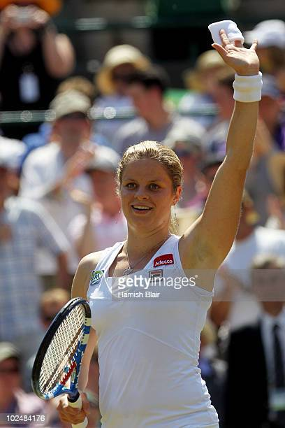 Kim Clijsters of Belgium celebrates match point during her match against Justine Henin of Belgium on Day Seven of the Wimbledon Lawn Tennis...