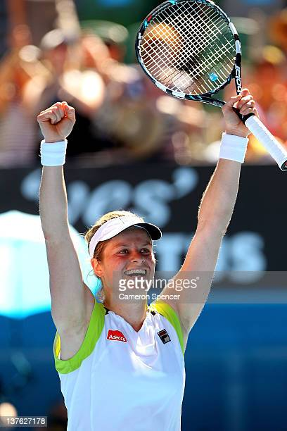 Kim Clijsters of Belgium celebrates winning her quarter final match against Caroline Wozniacki of Denmark during day nine of the 2012 Australian Open...