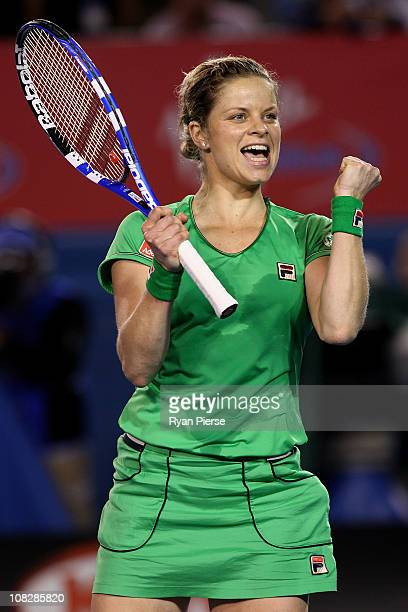 Kim Clijsters of Belgium celebrates winning match point in her fourth round match against Ekaterina Makarova of Russia during day eight of the 2011...
