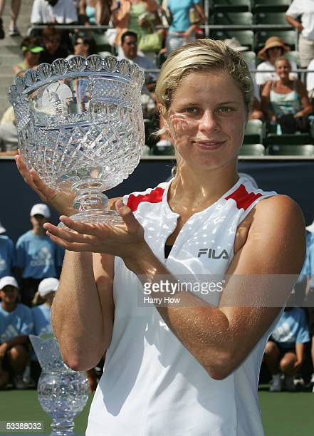 Kim Clijsters of Belgium celebrates with the championship trophy after defeating Daniela Hantuchova of Slovakia in the JPMorgan Chase Open finals...