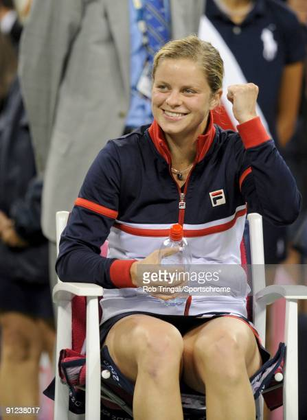 Kim Clijsters of Belgium gestures to her family after defeating Caroline Wozniacki of Denmark in the Women's Singles final on day fourteen of the...