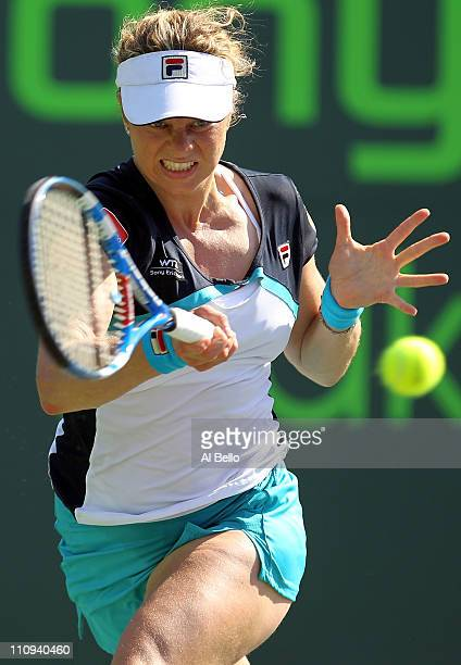 Kim Clijsters of Belgium hits a forehand return against Maria Jose Martinez Sanchez of Spain during the Sony Ericsson Open at Crandon Park Tennis...