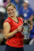 Kim Clijsters of Belgium holds up the championship trophy after defeating Caroline Wozniacki of Denmark in the Women�s Singles final on day fourteen...