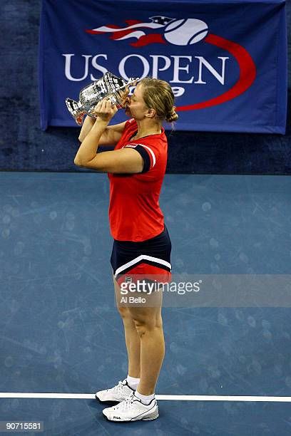Kim Clijsters of Belgium kisses the championship trophy after defeating Caroline Wozniacki of Denmark in the Women�s Singles final on day fourteen of...