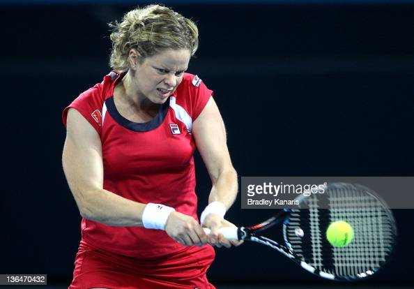 Kim Clijsters of Belgium plays a backhand against Daniela Hantuchova of Sovlakia in their Women's semi final match during day six of the 2012...