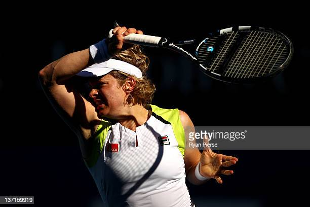 Kim Clijsters of Belgium plays a forehand during her round one match against Maria Joao Koehler of Portugal during day one of the 2012 Australian...