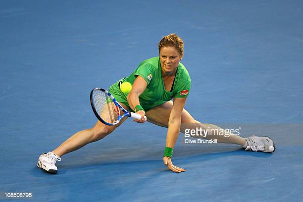 Kim Clijsters of Belgium plays a forehand in her women's final match against Na Li of China during day thirteen of the 2011 Australian Open at...