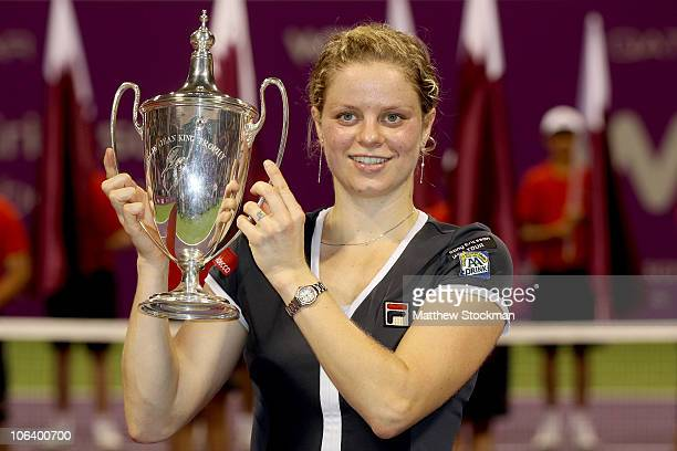 Kim Clijsters of Belgium poses for photographers after defeating Caroline Wozniacki of Denmark in the singles final on day six of the WTA...