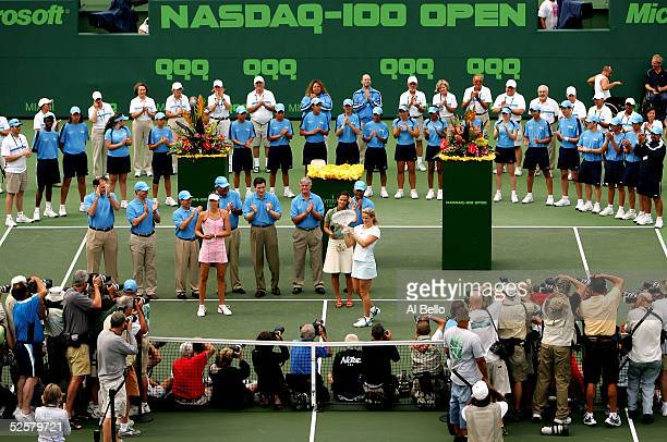 Kim Clijsters of Belgium poses for photographers with the trophy after defeating Maria Sharapova of Russia in the women's final during the NASDAQ100...